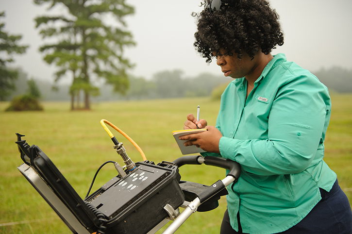 Researcher performing GPR survey
