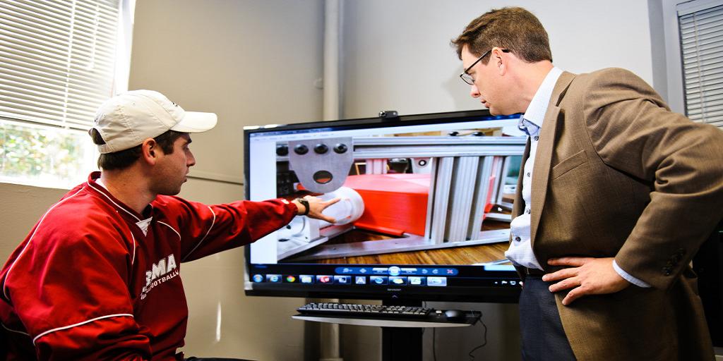 researchers analyzing 3D model